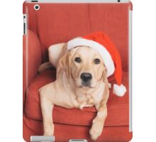Dog with Christmas hat on armchair iPad Case/Skin