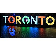 Toronto Sign All Lit Up With Umbrella Silhoette Photographic Print
