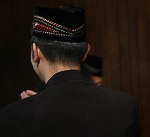 man in muslim costume by bayu harsa