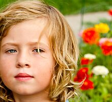 A boy in a flower field by deahna