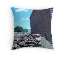 pile of wood next to a barn Throw Pillow