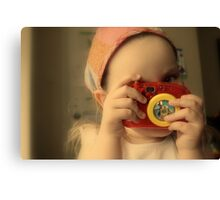 Girl with toy camera Canvas Print