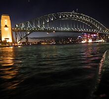 Sydney Harbour Bridge from a Ferry at night! by Bernie Stronner
