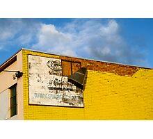 Shady Billboard on Yellow Wall Photographic Print