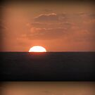 Sunset At Sea by mikequigley