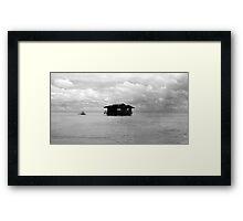Floating house Framed Print