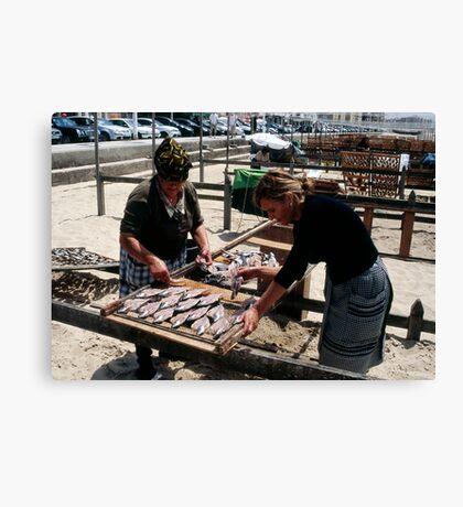 The Ladies Of Nazaré Tend Their Fish Canvas Print