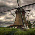 A windmill near Buitenkaag, Holland by Mike Olbinski