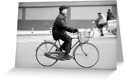 In bicycle in Beijing. by Jean-Luc Rollier