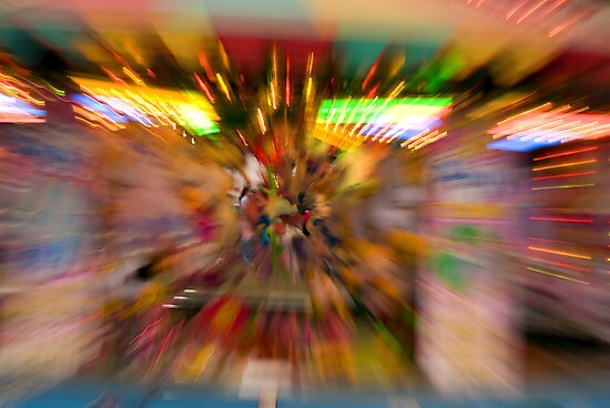 Slow shutter speed zoom burst effect at the Fair by buttonpresser