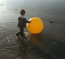 Boy Playing on the beach by DaylightMagic