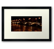Stone bridge and waves on river by night Framed Print