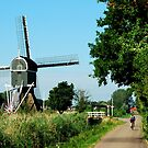 Cycling along the windmill by jchanders