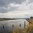 Entrance into Southwold Harbour by Karen  Betts