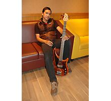 man holding guitar Photographic Print