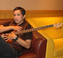 man holding guitar by bayu harsa