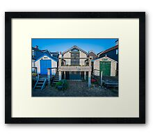 Three beach huts on the beach of Whitstable in Kent Framed Print