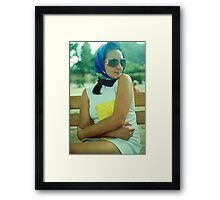 attractive girl sitting on a bench Framed Print