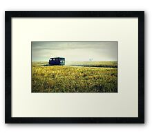 bus sped along the road on the field Framed Print