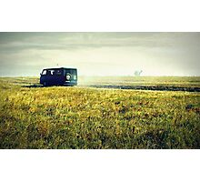 bus sped along the road on the field Photographic Print
