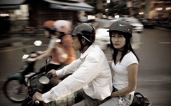 Vietnam.  Scooter couple by geofflackner