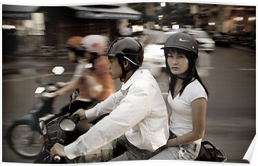 Vietnam.  Scooter couple by geofflackner