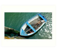 Small boat with paddles Art Print
