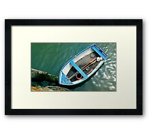 Small boat with paddles Framed Print