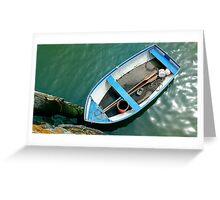 Small boat with paddles Greeting Card