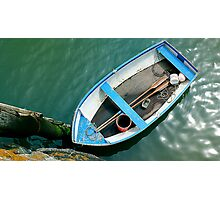 Small boat with paddles Photographic Print