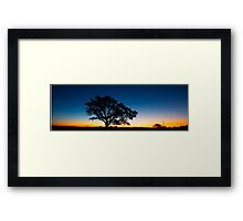 Panorama of a silhouette tree at dusk. Framed Print