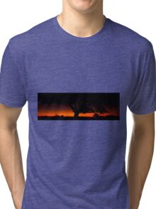 Panorama of a silhouette tree at dusk. Tri-blend T-Shirt