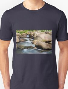Rocks covered in moss in a creek bed. Unisex T-Shirt