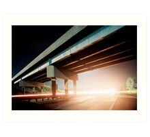 Car gliding under the highway Art Print