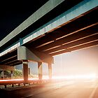 Car gliding under the highway by agenttomcat