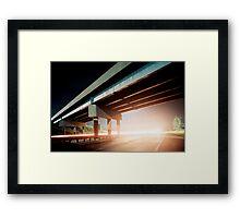 Car gliding under the highway Framed Print
