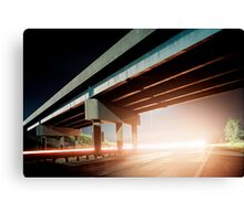 Car gliding under the highway Canvas Print
