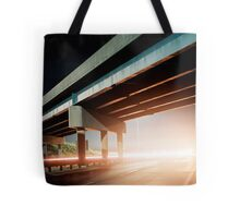 Car gliding under the highway Tote Bag