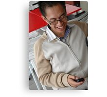 young executive holding mobile phone Canvas Print
