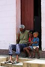 A smoke on the doorstep, Trinidad, Cuba by David Carton