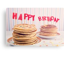 Pancakes piled up decorated with birthday candles Canvas Print