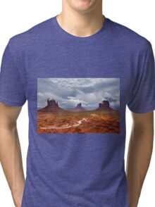 Storm clouds clear over Monument Valley Tri-blend T-Shirt