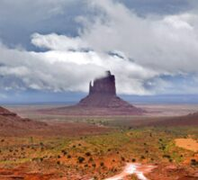 Storm clouds clear over Monument Valley Sticker