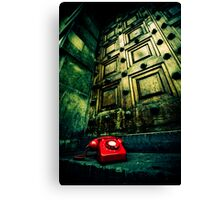 Retro red phone outside a spooky wooden door Canvas Print