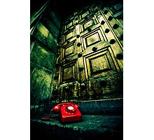 Retro red phone outside a spooky wooden door Photographic Print