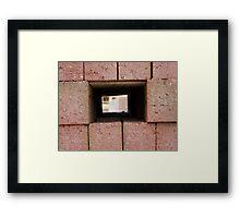 Through the brick wall Framed Print
