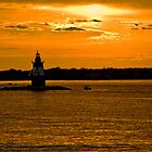 Golden Lighthouse near Plum Island by Rick Gold