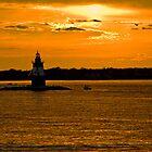 Golden Lighthouse near Plum Island by Rick Gold