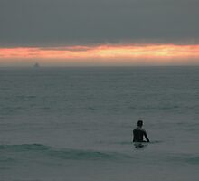 Surfing during sunset at Godrevy, Cornwall by rkdownton