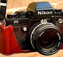Nikon F3 HP In Leather Jacket by Raoul Isidro